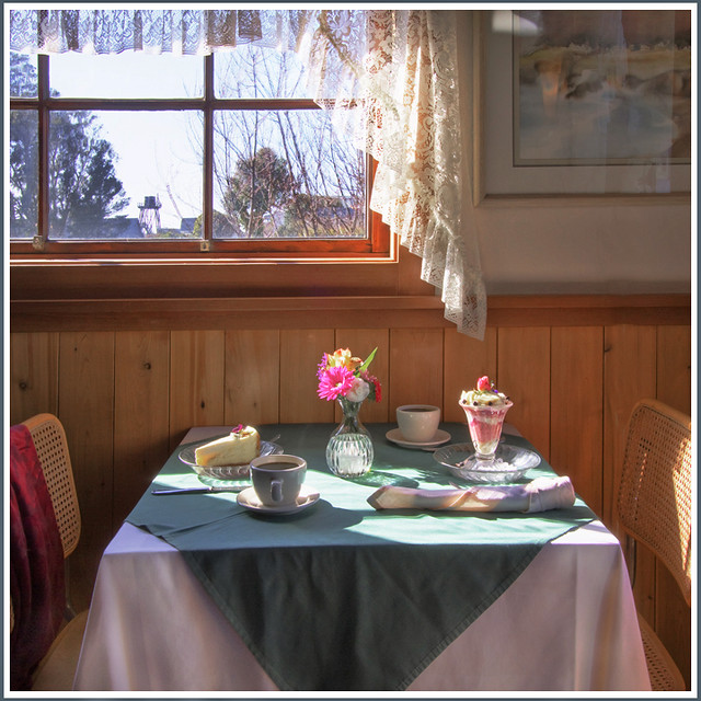 Rita Crane Photography: Table setting / Window / Sunlight / Desserts / Restaurant 955 Mendocino / Vintage / Teacups / Table for Two for Afternoon Tea, Mendocino