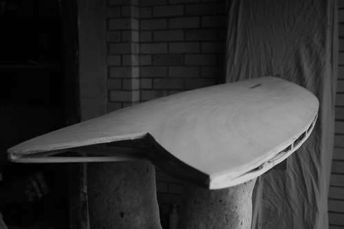 Wooden surfboard – tail view