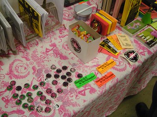 Buttons, Hello Kitty candy, free stickers, mini zines and more
