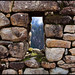 View of Andes mountains through a stone window