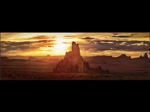 light sunset arizona sun silhouette landscape interestingness rocks pano monumentvalley hdr 30d