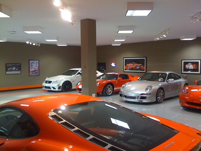World 39 s most beautiful garages exotics insane garage for Garage happy car
