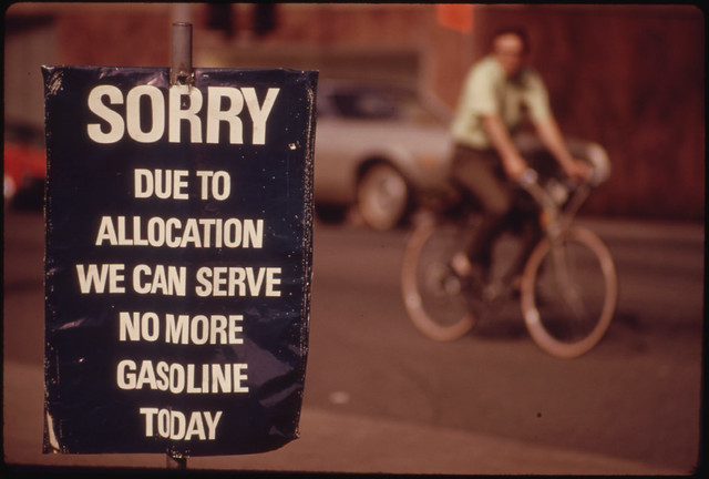 Oregon Still Had Scattered Gasoline Problems in May, 1974. A Downtown Station in Portland Shows a Sign Saying the Day's Allocation Is Sold Out. A Bicycler Uses an Alternate Method of Transportation 05/1974