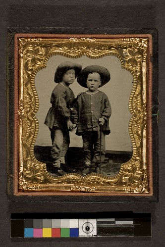Portrait of a two children wearing hats