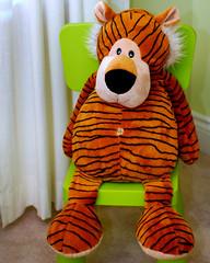 orange(1.0), textile(1.0), tiger(1.0), plush(1.0), stuffed toy(1.0), mascot(1.0), toy(1.0),