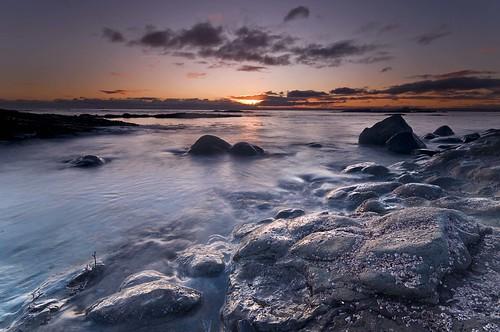 blue sea sky orange clouds sunrise coast scotland rocks fife estuary barnacles coastline d300