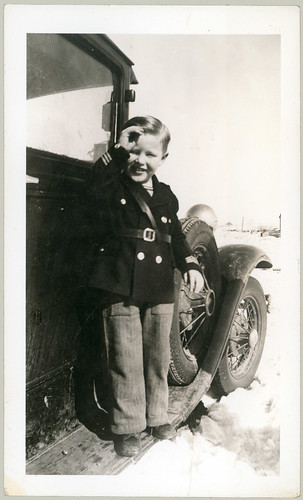 Boy in uniform on running board
