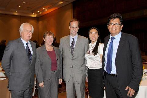U.S. Ambassador to Chile Paul Simons (center) participates ...