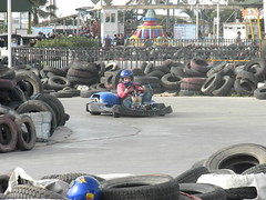auto racing(0.0), monster truck(0.0), automobile(1.0), tire(1.0), automotive tire(1.0), go-kart(1.0), kart racing(1.0), racing(1.0), sport venue(1.0), vehicle(1.0), race track(1.0),