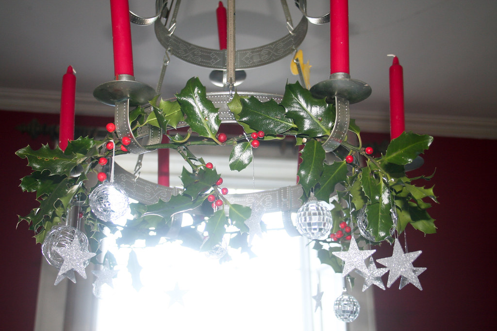 craft werk decorating a chandelier in christmas style