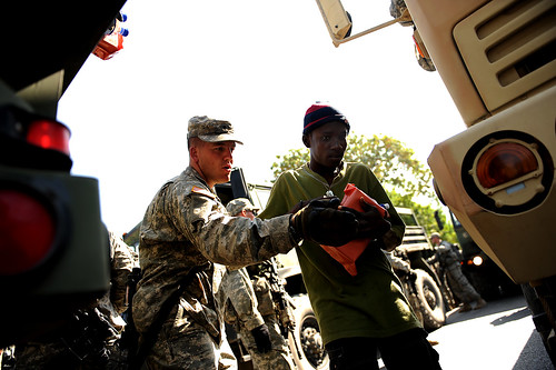 U.S. Soldier hand out food and water in Haiti