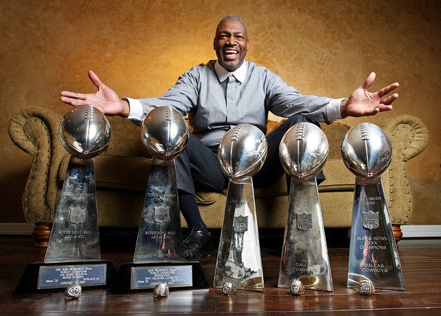 Former Dallas Cowboy star Charles Haley poses at his Dallas home with his unprecedented five Super Bowl rings and trophies, won while playing first in San Francisco (two on the left), then Dallas (three on the right). Haley is up for admission to the Pro Football Hall Of Fame. Fort Worth Star-Telegram / Paul Moseley