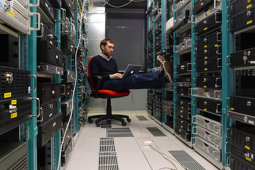 Man at work in a data center.