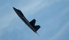 northrop grumman b-2 spirit(0.0), bomber(0.0), lockheed martin f-22 raptor(1.0), aerobatics(1.0), aviation(1.0), airplane(1.0), wing(1.0), vehicle(1.0), fighter aircraft(1.0), blue(1.0), sky(1.0), jet aircraft(1.0), flight(1.0), air force(1.0), air show(1.0),