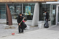 Cleaning outside the meeting venue Katuaq