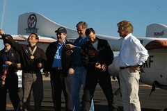 Burt Rutan celebrates Brian Binnie's successful X Prize flight with Peter Diamandis, Brian and Sir Richard Branson. 2004