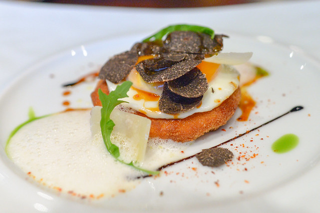 Le Oeuf de Poule crispy polenta with fried egg and shaving Parmesan cheese (black truffle supplement)