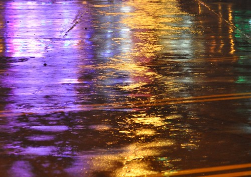 blue red color reflection green water rain yellow puddle rainbow texas purple tx lot rowlett paerking