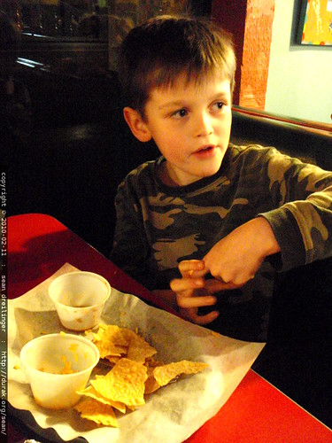 nick demonstrating gang signs at the restaurant table   P2100081