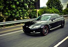 automobile(1.0), automotive exterior(1.0), wheel(1.0), vehicle(1.0), performance car(1.0), automotive design(1.0), rim(1.0), bumper(1.0), land vehicle(1.0), luxury vehicle(1.0), mazda rx-8(1.0), coupã©(1.0), supercar(1.0), sports car(1.0),