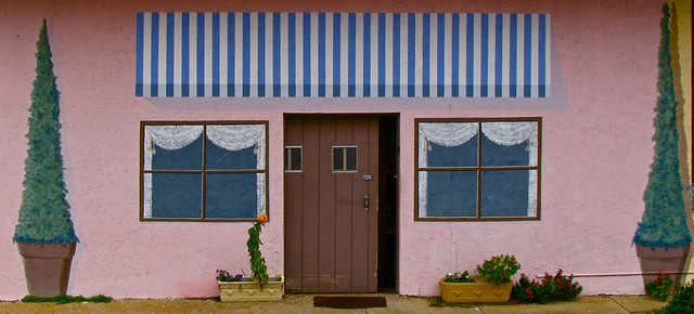 Painted Windows Awning Plants Cloudy Sky And No