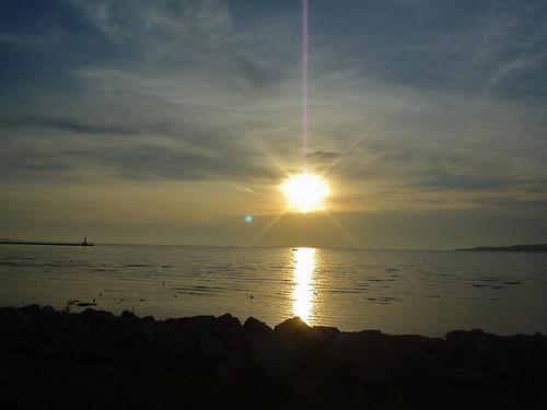 sunset sun lake water bay michigan lakemichigan cirrus petoskey littletraversebay