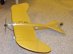 glider(0.0), piper j-3 cub(0.0), canard(0.0), model aircraft(1.0), monoplane(1.0), airplane(1.0), propeller driven aircraft(1.0), yellow(1.0), wing(1.0), vehicle(1.0), light aircraft(1.0), radio-controlled aircraft(1.0), propeller(1.0), aircraft engine(1.0), toy(1.0),