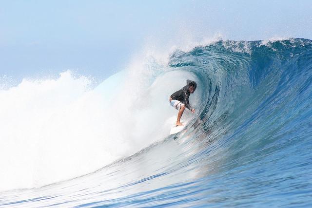 Dennis Tihara riding it out at Teahupoo, Tahiti.