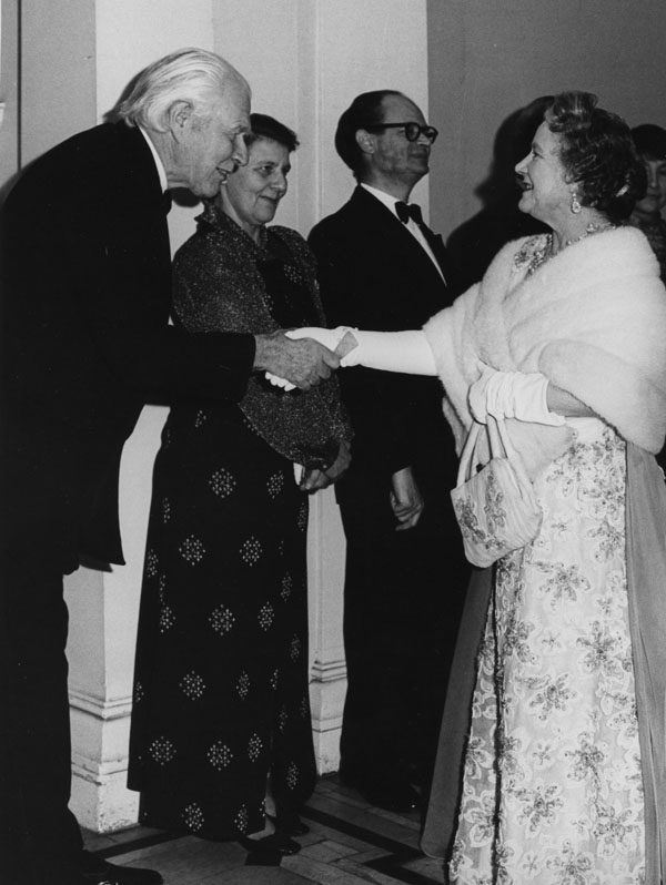 Banqueting House Concert in aid of the Library Appeal, 1974. L-R: Lord Robbins, Mrs Grunfeld, Professor Cyril Grunfeld, HM Queen Mother. Taken by Derek Summers. Credit: LSE Library