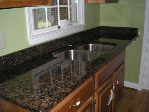Dark baltic brown granite countertop with sink for Brown kitchen cabinets with black granite