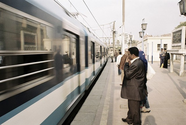 man waiting for train in cairo