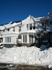 Snow banks in front of the house