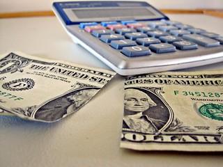 Calculator and $1 Cut in Half