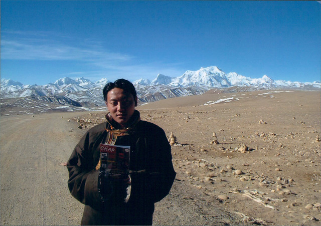 Pemsi, a copy of The Chap magazine, and the Himalayas, at the top of the Friendship Highway