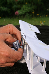 Paper Paper Airplane 2 Photos | Man placing a battery in a Curtis Boat Plane sty