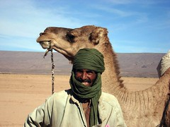 Nomad and camel in Merzouga Morocco