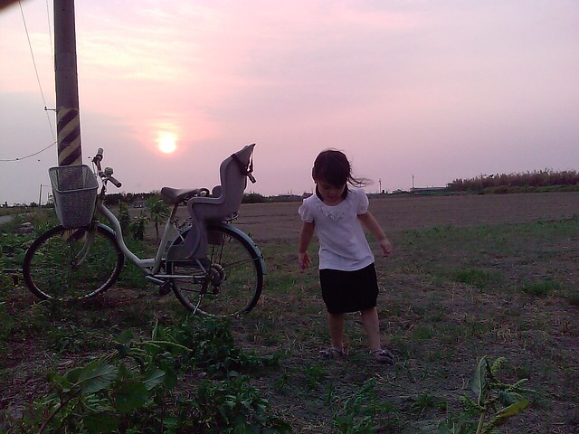 Christina, the bike and the sun