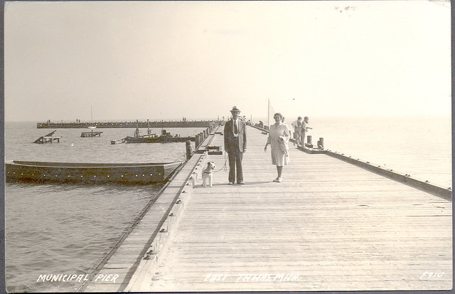 East tawas mi old view of municipal pier with people fishi for Harrison fishing pier
