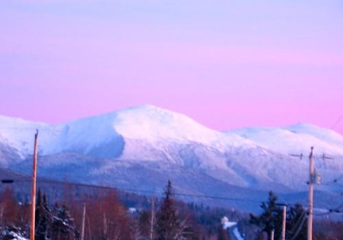 road new pink trees sunset sky white snow mountains washington utility hampshire mount poles route2