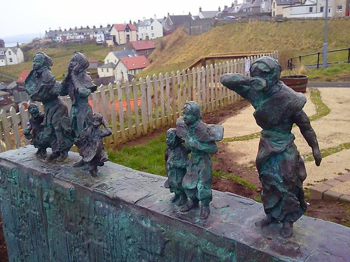 The bronze figures of Eyemouth Fishing Tragedy Memorial at St Abbs