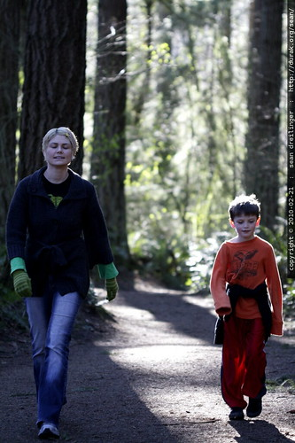 mother and son walking in the woods