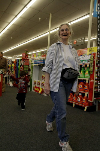 pied piper grandma leading the reluctant grandson out of rite aid drugstore