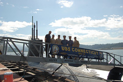 In this file photo from Subic Bay, Philippines in January 2010, representatives from the Philippine National Police and USAID visit USS Connecticut (SSN 22) for a tour and luncheon while the boat was in port for a visit. Connecticut Sailors are currently operating in an opposite climate, taking part in Ice Exercise 2011 in the Artic Ocean. (U.S. Navy photo by Lt.j.g. Lucas B. Schaible)
