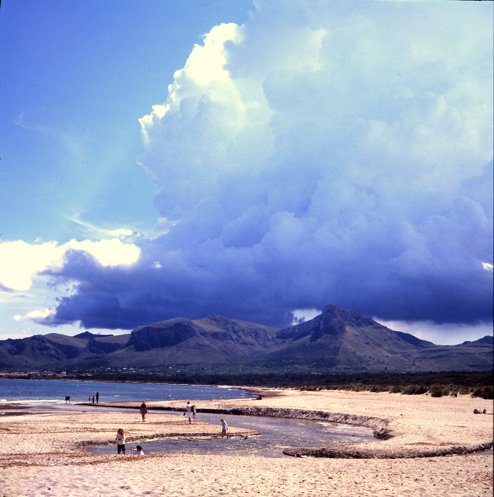 beach, clouds and montains