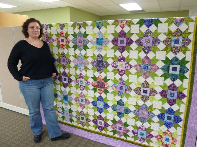 Sheila with her anniversary quilt