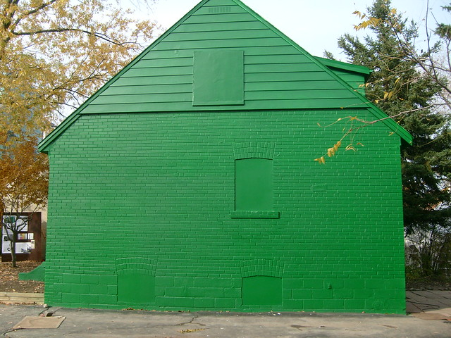 green monopoly house sideways