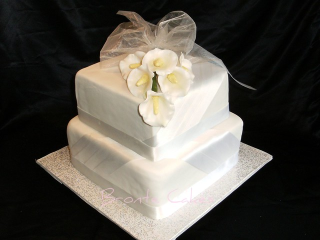 Wedding cakerich dark fruit cake iced with fondant Calla Lilies made