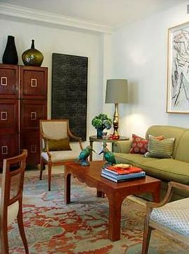 Colorful + eclectic: Moroccan table + green sofa