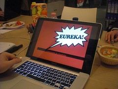 laptop monitor with a word bubble saying EUREKA