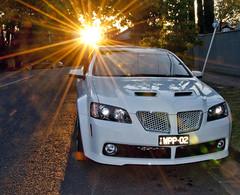 wheel(0.0), auto show(0.0), automobile(1.0), automotive exterior(1.0), vehicle(1.0), automotive design(1.0), compact car(1.0), bumper(1.0), pontiac g8(1.0), land vehicle(1.0), luxury vehicle(1.0),